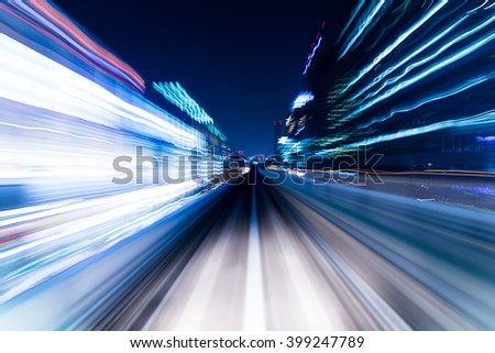 Speed motion in urban highway road tunnel - stock photo