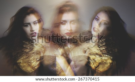 Speed, nude brunette woman with flowing hair and jacket with golden wings - stock photo