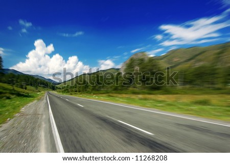 speed on a empty mountain road, motion blur - stock photo