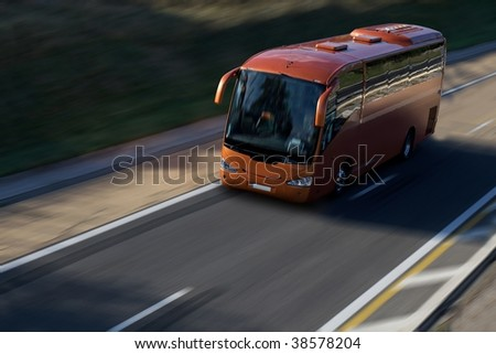 speed red bus on highway - stock photo