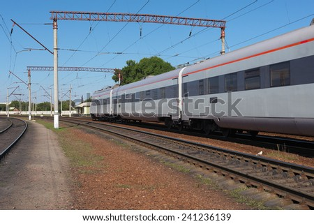 Speed regional train departing from the station - stock photo