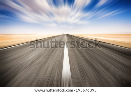Speed road across the salt lake of Chott El Djerid, Tunisia. - stock photo