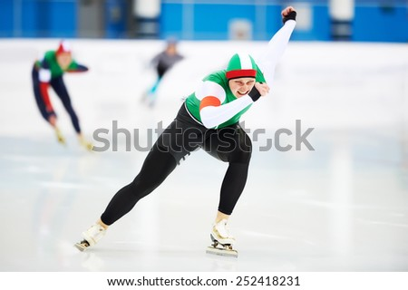 Speed skating male sportsman during competition race  - stock photo