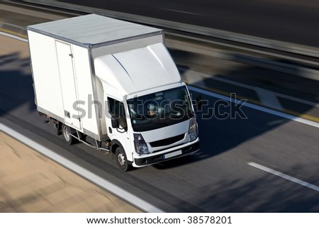 speed white shipping on highway - stock photo