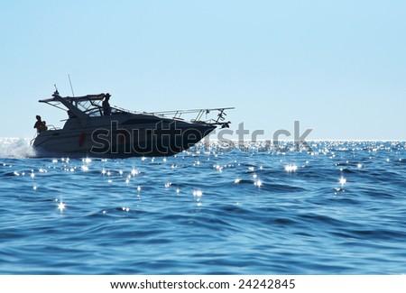 Speedboat on sparkling water - stock photo