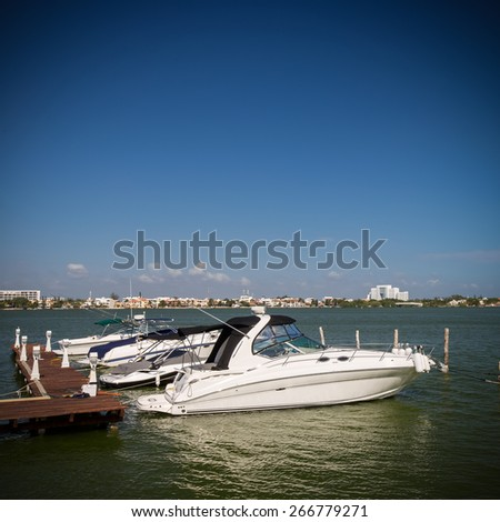 Speedboats moored to a jetty at tropical lagoon  - stock photo