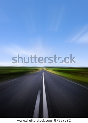 Speeding along a straight road - blurred motion