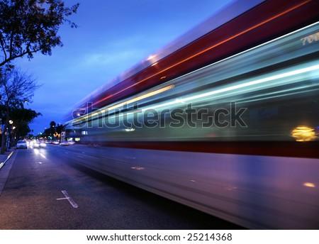 Speeding bus, blurred motion. Santa Monica Blvd., West Hollywood, USA - stock photo