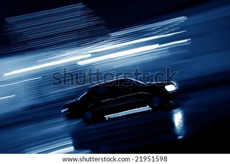 Speeding car at night - stock photo