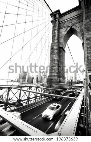 Speeding car on Brooklyn Bridge. High contrast modern monochrome black and white processed - stock photo