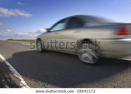 Speeding car on the mountain road. Volvo. Road A57. Peak District National Park, England. - stock photo