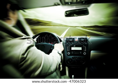 speeding car on the road,shoot in this car. - stock photo