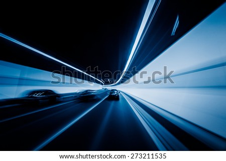 speeding car through the tunnel. - stock photo