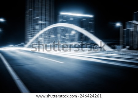 speeding lights of cars in city at night.