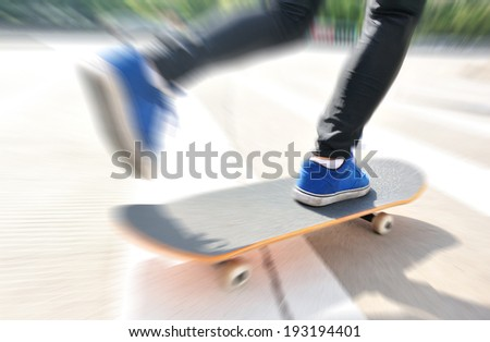 speeding skateboarding woman on zebra crossing road