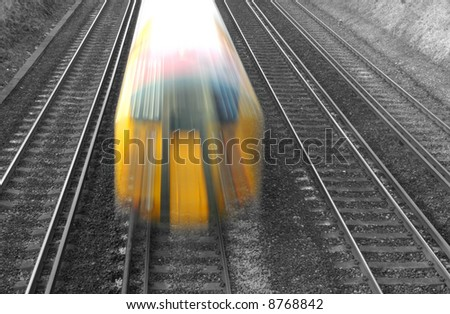 speeding train on black and white tracks - stock photo