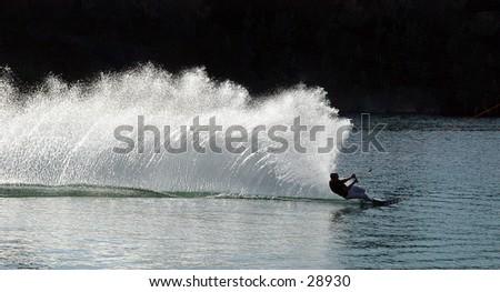 Speeding waterskiier  - stock photo
