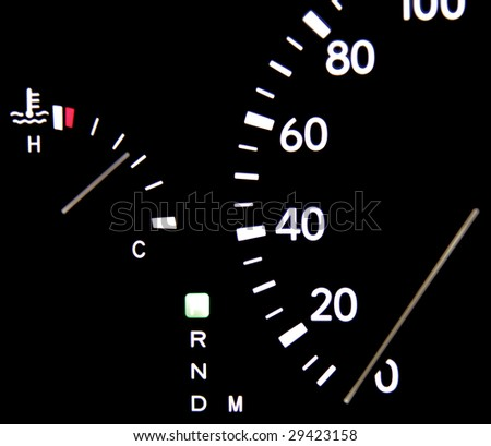 Speedometer in car, fuel, black background, auto