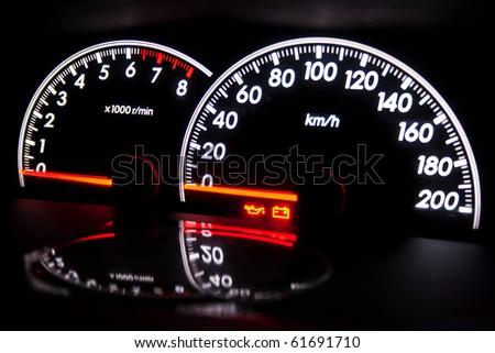 Speedometer on dashboard - stock photo