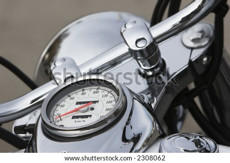 Speedometer on the tank of a highly chromed motorcycle