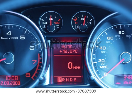 Speedometer, rev counter, fuel and temperature gauge of a sports car dashboard - stock photo