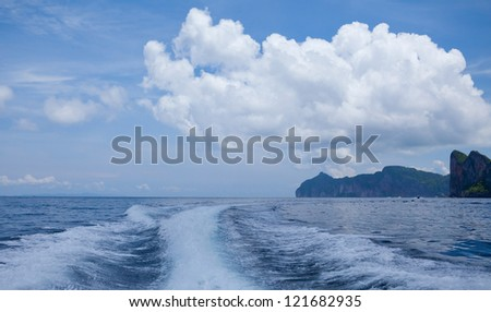 speedy boat prop wash, white wake on the blue ocean sea - stock photo
