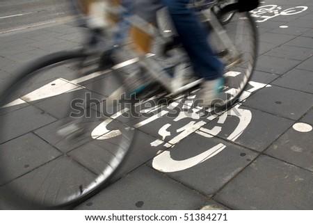 Speedy cyclist commuting on an urban cycleway. - stock photo