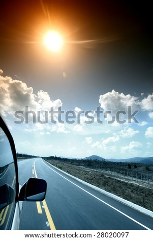 speedy day drive on car - stock photo