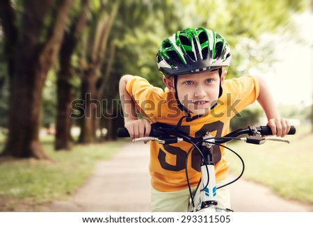 Speedy little racer on bicycle  - stock photo