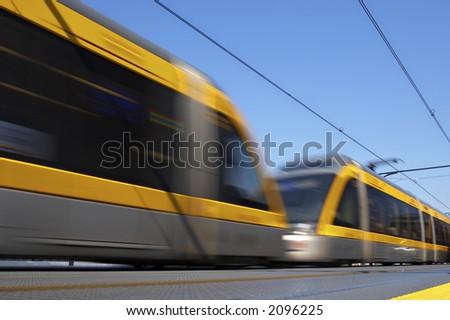 speedy train in blurriness of motion - stock photo