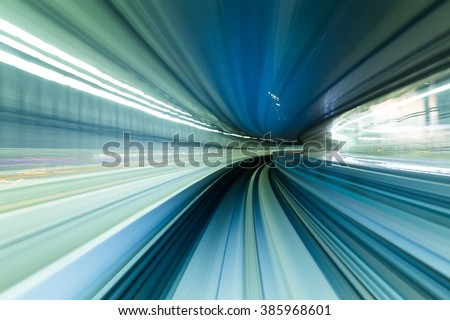Speedy train moving in tunnel - stock photo