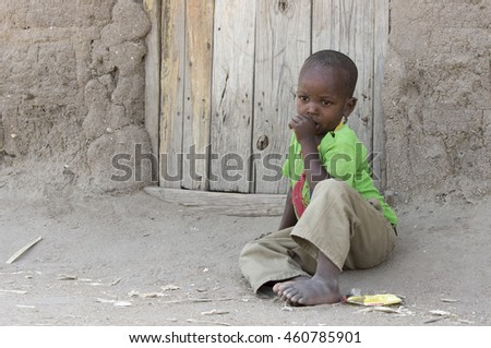 Speke Bay, Lake Victoria, Fisherman's village (24/07/2015) A young Ethnic boy sitting in front of the door of his house. Tanzania, (24/07/2015)