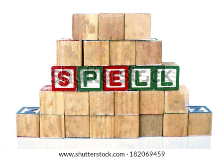 SPELL in alphabet word blocks isolated on a white background                                  - stock photo