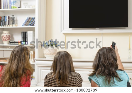Spending time on TV together at home - stock photo