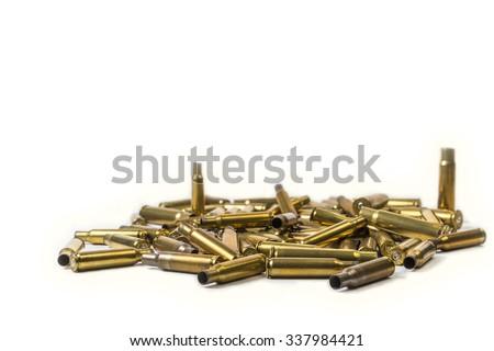 Spent cartridge cases isolated on white background - stock photo