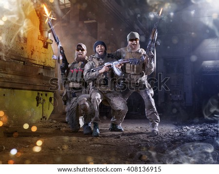 Spesial forces soldiers celebrates victory in the hard battle - stock photo