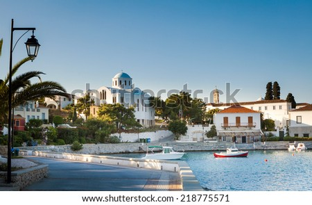 Spetses Town promenade on the Aegean island of Spetses, Greece, showing the old Monastery of Agios Nikolaos which is now the island's cathedral. - stock photo