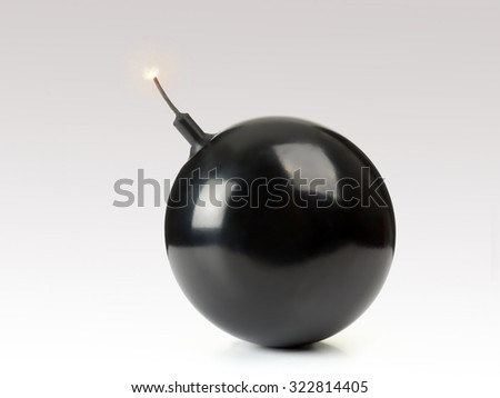 Sphere-shaped black bomb with a burning fuse