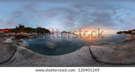Spherical, 360 degrees panorama of a rocky coast of Andaman sea near Laem Sing beach at sunset. Phuket, Thailand - stock photo