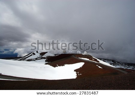 Spherical shaped observatory and snow on the summit of Mauna Kea in Hawaii - stock photo
