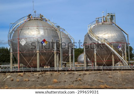 Spherical tanks containing fuel gas oil refineries. - stock photo