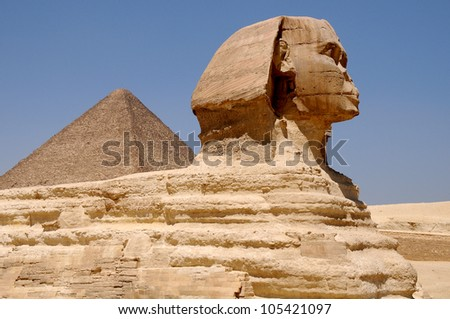Sphinx against pyramids