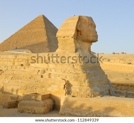 Sphinx and pyramid in Egypt - stock photo