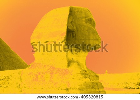 Sphinx at sunset, with pyramids in background, , Giza, Egypt, Middle East - stock photo