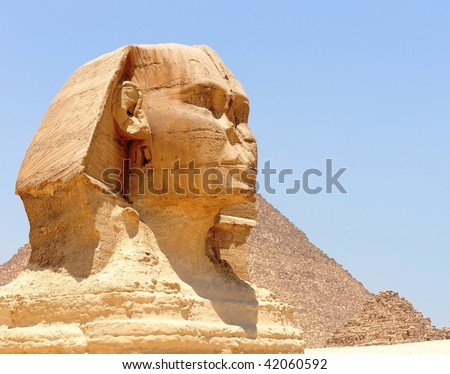 Sphinx with pyramid in background