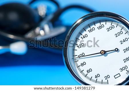 Sphygmomanometer on blue background  - stock photo