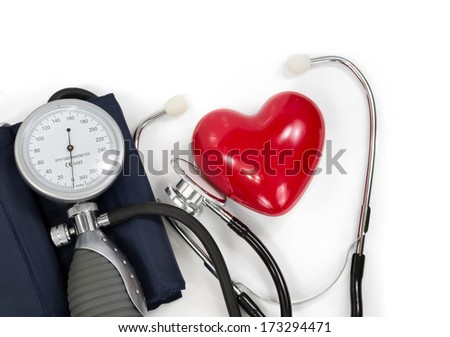 sphygmomanometer with heart and stethoscope  - stock photo