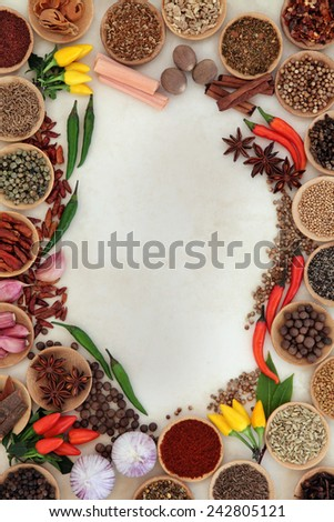 Spice and herb abstract border over parchment background. - stock photo
