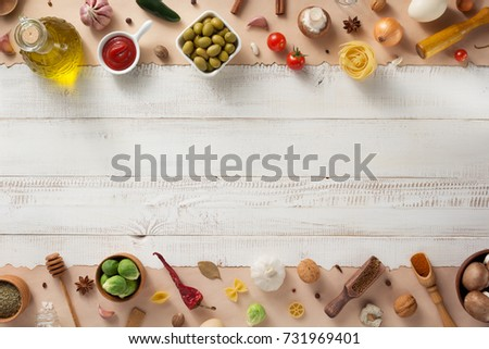 spice and herbs ingredients at wooden background