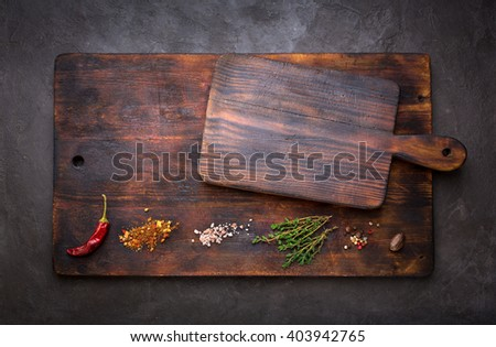 Spice for cooking and empty cutting boards on a dark background. Food background with copyspace. Top view - stock photo